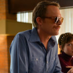 "Paul Bettany and Sophia Lillis stand in a motel lobby in the film ""Uncle Frank"""