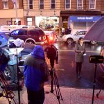 Syndication: NorthJersey: Members of the media set up across the street from the Jersey City Kosher Supermarket after a shoot out with police in Jersey City, N.J. One police officer, the two shooters and three civilians were killed.After The Shooting