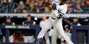 Oct 18, 2019; Bronx, NY, USA; New York Yankees shortstop Didi Gregorius (18) hits a single against the Houston Astros during the fourth inning of game five of the 2019 ALCS playoff baseball series at Yankee Stadium. Mandatory Credit: Noah K. Murray-USA TODAY Sports