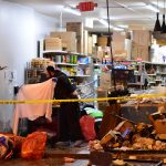 Syndication: NorthJersey: A clean up crew sifts through the debris at the Jersey City Kosher Supermarket after a shoot out with police in Jersey City, N.J. on Wednesday Dec. 11, 2019. One police officer, the two shooters and three civilians were killed.After The Shooting