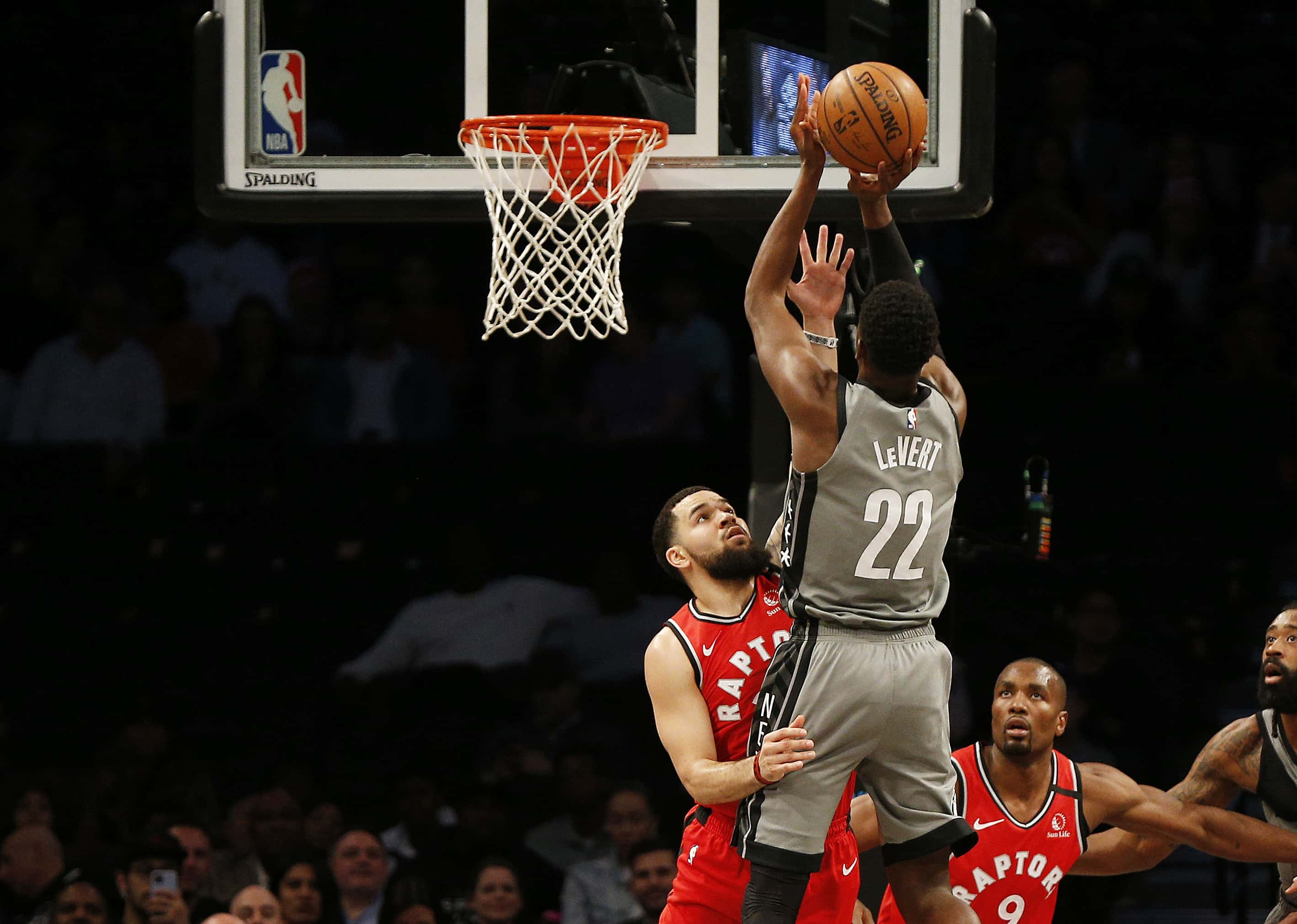 Feb 12, 2020; Brooklyn, New York, USA; Brooklyn Nets guard Caris LeVert (22) shoots over Toronto Raptors guard Fred VanVleet (23) during the first half at Barclays Center. Mandatory Credit: Andy Marlin-USA TODAY Sports