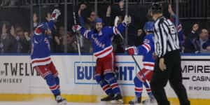 Mar 5, 2020; New York, New York, USA; New York Rangers center Mika Zibanejad (93) celebrates his fourth goal of the game against the Washington Capitals with teammates during the third period at Madison Square Garden. Mandatory Credit: Brad Penner-USA TODAY Sports