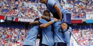 Jun 24, 2017; Harrison, NJ, USA; New York City FC defender RJ Allen (27) celebrates a goal scored by NYCFC defender Ben Sweat against the New York Red Bulls during the second half at Red Bull Arena. Mandatory Credit: Adam Hunger-USA TODAY Sports