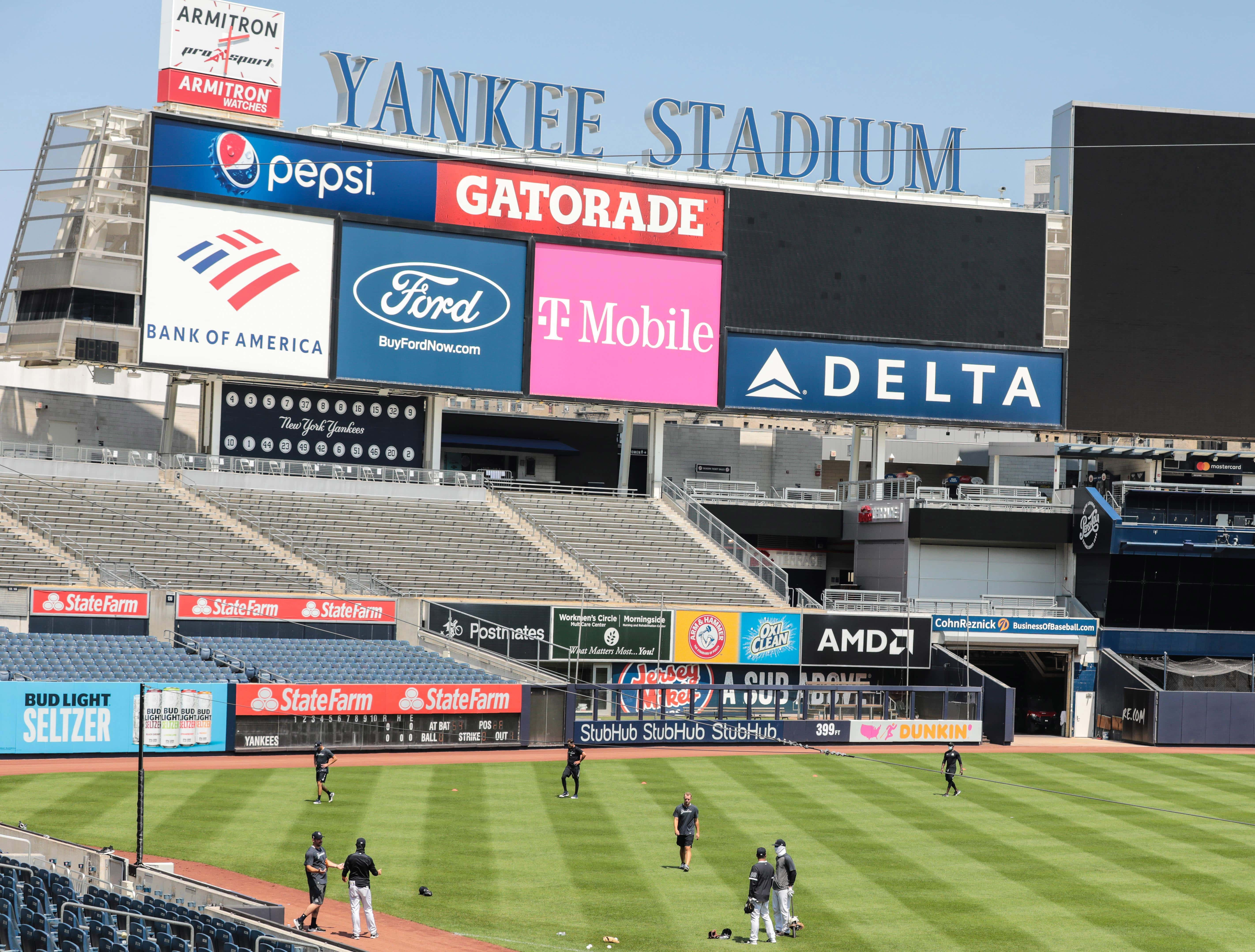 Jul 6, 2020; Bronx, New York, United States; New York Yankees players workout in left field at Yankee Stadium. Mandatory Credit: Vincent Carchietta-USA TODAY Sports