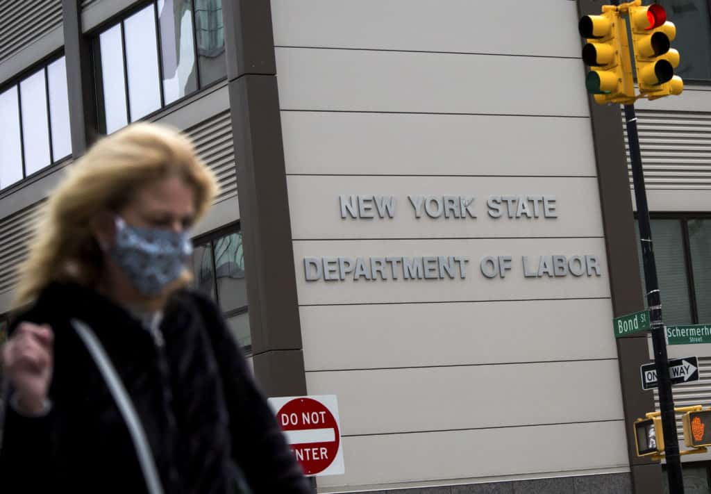 pedestrian walking past building