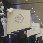 Election 2020 New York: Polling site clerk Ronald Green sanitizes a voting booth at the Madison Square Garden's early voting polling site, Saturday Oct. 24, 2020, in New York. (AP Photo/Bebeto Matthews)