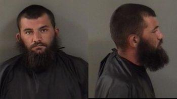 bearded man mugshot