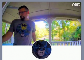 nest cam pic of man with batman shirt