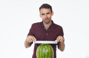 idiot trying to cut a watermelon