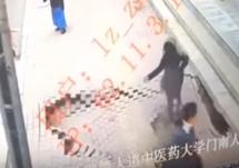 woman falls in sinkhole on sidewalk