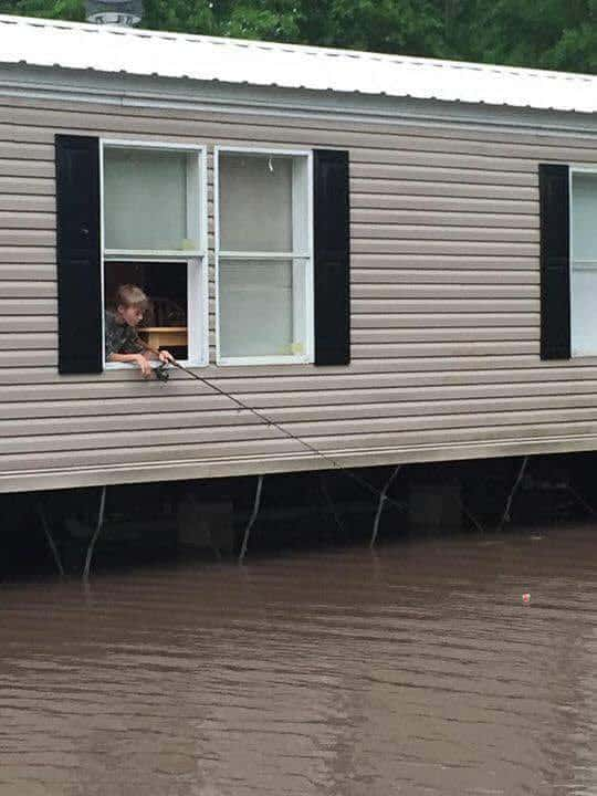 boy fishing from mobile home