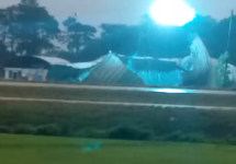 metal roof takes out telephone pole with blue sparks