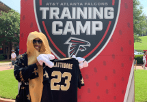 saints fan at falcons training camp with lattimore jersey