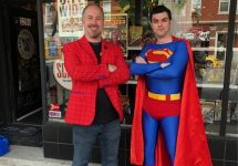 comic collector with man dressed as superman