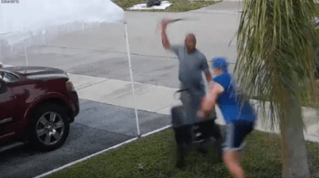 man swings sword after another man fighting over utility cart