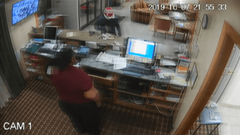 surveillance footage of a bank robbery where robber leaves gun on counter