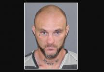 mugshot of matty b with name tattooed on his neck