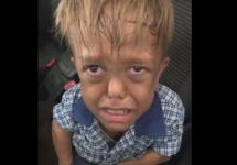 boy crying in car