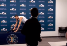 rudy gobert runs hands all over microphones