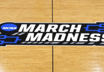 march madness logo on court