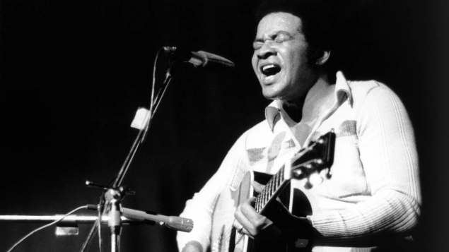 bill withers singing black and white photo